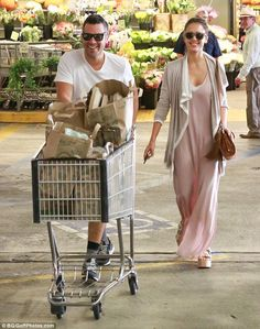 Plenty to smile about: The 34-year-old actress looked picture-perfect in a chic blush-colo...