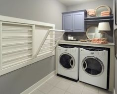 Like the pull down drying racks.  Probably would have stacked the washer/dryer but then of course in this room you'd loose you folding space. Replace circular dryers with fold Dow one above dryer