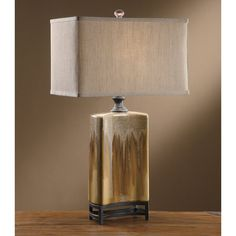 The Crestview Collection Coaston Table Lamp showcases a concave silhouette that's topped by a rectangular linen shade. The column boasts a caramel. Western Lamps, Old Time Pottery, Crestview Collection, Living Room End Tables, Living Area, Lamp Shade Store, Ceramic Table Lamps, Wood Lamps, Tiffany Lamps