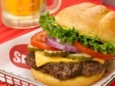 """Just in time for July 4th, Smashburger shares with us how to """"smash"""" a burger at home.  A full gourmet burger recipe is included too."""