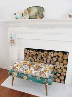 love the logs in the fireplace and the wee delicate crochet lace bunting
