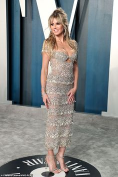 Dazzling display: Heidi looked incredible in a flirty sequinned dress with a low-cut bodic...