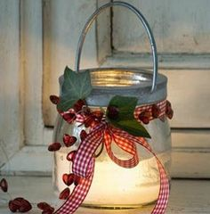 beautiful jar lantern with red and white gingham ribbon and ivy