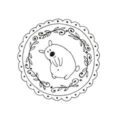 Embroidery pattern of a curious, perplexed little bear, surrounded by vines and scallops. This pattern has instructions for transferring the