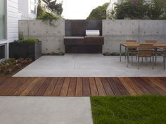 concrete + wood modern patio, dining terrace; Christopher Yates Landscape Architecture http://www.homedit.com/outdoor-oven-ideas-for-summer-fun/?utm_content=buffer7860a&utm_medium=social&utm_source=pinterest.com&utm_campaign=buffer The wooden path really works well to break up the space
