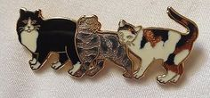 Gold tone and enamel CAT BROOCH