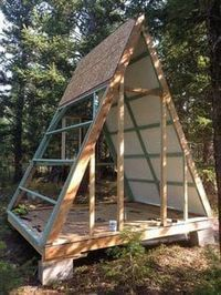 Couple builds tiny A-frame cabin with old wood Tiny Cabins, Tiny House Cabin, Tiny House Plans, Cabin Homes, Tiny Cabin Plans, A Frame Cabin Plans, A Frame House, Cabins In The Woods, Shed Plans