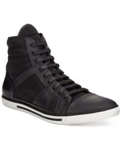 Kenneth Cole combines leather and neoprene for ultimate flexibility in these premium fashion high-tops.