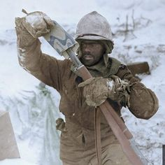 """the_ww2_memoirs An American GI belonging to """"K"""" Company, 393rd Infantry Regiment, 99th Infantry Division, with his skin burned by the frigid cold and smudged by gunpowder puts a """"K"""" Ration (Contained contents for dinner) over the barrel of his M1 Garand as a make-shift barrel cover, Elsenborn Ridge, Belgium, December/January, 1944/1945. This photo is just overwhelming and I cannot even fathom what he he went through and experienced. It also shows you the desperate times American troops faced…"""