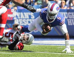 Buffalo Bills quarterback Tyrod Taylor (5) is tackled by Arizona Cardinals middle linebacker Kevin Minter (51) during the first half of an NFL football game on Sunday, Sept. 25, 2016, in Orchard Park, N.Y.