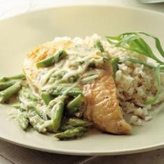 THIS DINNER IS AMAZING. http://www.eatingwell.com/recipes/chicken_asparagus_with_melted_gruyere.html