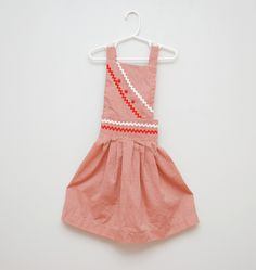 Vintage 1970s girl's checked apron.