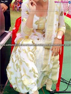Stunning White And Golden Embroidered Punjabi Suit