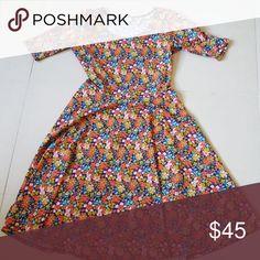 LULAROE NICOLE DRESS LULAROE FLORAL NICOLE DRESS.. NEW NEVER WORN LuLaRoe Dresses Midi