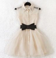 Cute cream coloured dress with a black bow