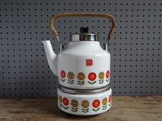 Vintage 1960s/70s enamel kettle with warmer stand. Lovely stylised flower design. Produced by Siegwerk of West Germany. Stands 26cm tall in total (including stand & handle).
