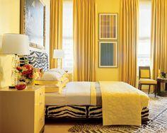 quarto com tinta de parede amarela
