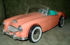 Barbie car - 1960s. someone said: I had this car and used to play with it with all other kinds of little stuffed animals and dolls - boy could I make up stories about going places in the car! When it was winter, I'd put a little yellow knitted square I made over the top to be the top of the car.