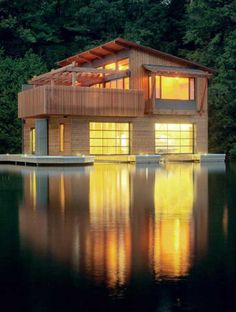 Muskoka Boathouse, Ontario, Canada. This is a renovated boathouse of 600 square feet by Christopher Simmonds Architects.