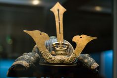 This appears to be a replica of the helmet of Kusunoki Masashige (楠木 正成) 1294 - July 4, 1336. Kusunoki fought for Emperor Go-Daigo in his attempt to wrest rulership of Japan away from the Kamakura shogunate and is remembered as the ideal of samurai loyalty.