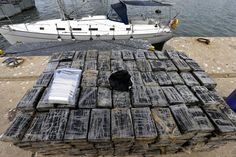 Portuguese Police display the 600 kilograms of cocaine found on a sailing-boat at Sagres harbor, Algarve, south of Portugal, October 16, 2014, after the arrest of 2 men. (EPA/LUÃS FORRA)