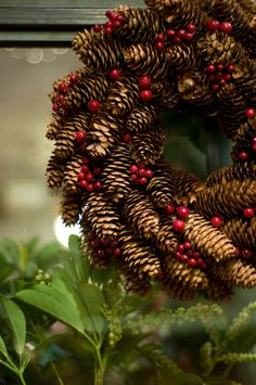 Pine cone wreath with some red berries