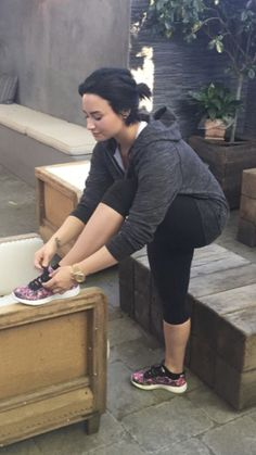 Demi makes tying your shoes look freaking sexy.