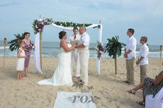 Ocean City Wedding Minister Sean Rox is the officiant  for this beautiful OC MD Beach Wedding. Archway and  decorations by Rox Beach Weddings:  https://www.roxbeachweddings.com/