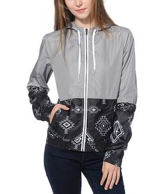 Add some stylish dimension to your daily look with this colorblock windbreaker jacket made with a solid grey upper and a black tribal print bottom panel.