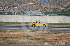 Airport Vehicle Checking The Runway - Download From Over 28 Million High Quality Stock Photos, Images, Vectors. Sign up for FREE today. Image: 47651074