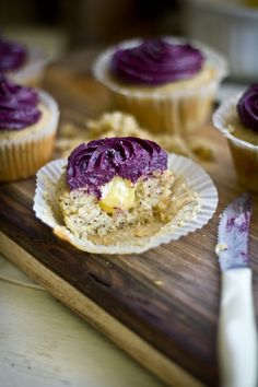 Lemon poppy seed cupcakes with blueberry cream cheese frosting.