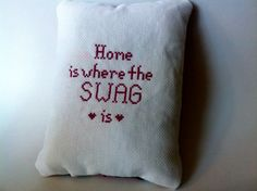 While Etsy has plenty of pillows and wall hangings cross-stitched with innocent cats and flowers, we also found some with much more sass.   Home is Where The SWAG is Needlepoint    http://mashable.com/2013/07/11/scandalous-needlepoints/