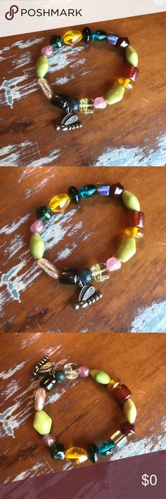 """Dragon Fly Beaded Bracelet NWOT - handmade. Faux silver dragon fly and glass beads. Elastic band. Appx 7"""" around. As with all fashion/costume jewelry, keep away from water, perfumes and lotions. J6217M Jewelry Bracelets"""