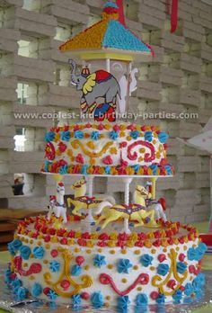 Circus PARTY!!!! this carousel cake is amazing looking!! Never would've thought of that!