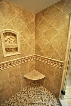 Custom shower tile with built-in shelf and a corner shower ...
