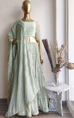 Description: BLOUSE - Chikankari bootis on Georgette fabric Deep back design with tassel tie-up Handmade. Floral Lehenga, Floral Blouse, Bridal Lehenga, Mirror Work Lehenga, Lehenga Online, Ethnic Looks, Green Saree, Indian Designer Outfits, Indian Outfits