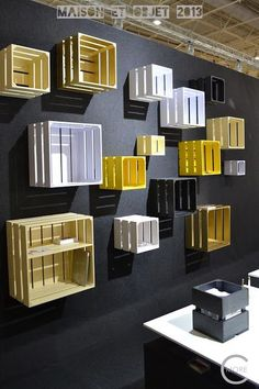 Using color well can make crates on a wall seem really special! Makes for good design, good merchandising. | www.bocadolobo.com #bocadolobo #luxuryfurniture #exclusivedesign #interiodesign #designideas #maisonetobjet #parisdesignweek #PDW17 #paris