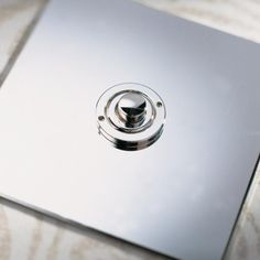 The Button Dimmer Controller is a push-to-make momentary action switch that controls an In-Line Dimmer Pack. The system allows dimming of a lighting circuit from more than one position. Nickel Silver, Polished Nickel, Designer Light Switches, Light Switches And Sockets, Dim Lighting, Door Furniture, Silver Buttons, Mirror, Spotlights