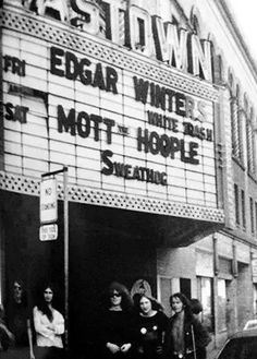 Mott the Hoople standing under the marquis at The Eastown Theatre, sadly slated for demolition some time this year. Detroit Area, Metro Detroit, Saint Lawrence Seaway, Great Song Lyrics, Ian Hunter, Mott The Hoople, All The Young Dudes, Vintage Rock, Greatest Songs