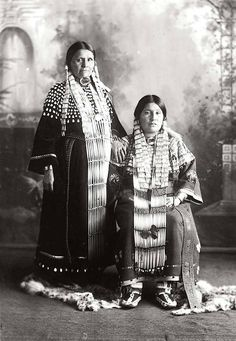 Mrs. Philip Bull Head and Mrs. James Gayton. Sioux. Early 1900s. Photo by F.B. Fiske. Source - State Historical Society of Nebraska.