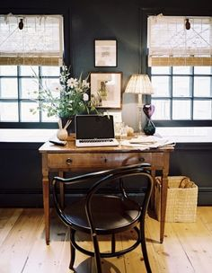 Dark walls, desk in front of windows, beautiful wood floors, antique chair, love it all!