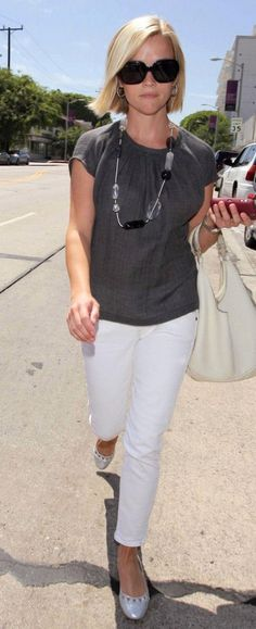 Celebrity Fashion: Reese Witherspoon in white capris and gray linen blouse with black and white and silver accessories