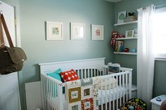 Modern Nursery contemporary kids -- love the bold pattern on the pillow, color of walls with white accents, and shelves on both sides of the window.