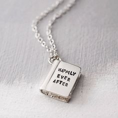 "Silver Story Book Necklace: ""Once Upon a Time"" engraved on the front 'Happily Ever After' engraved on the back"
