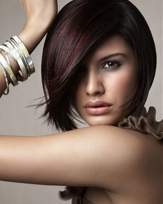 modern hair. chic cut. I love the red highlights and dark hair. looks glam and expensive. would work with any color.