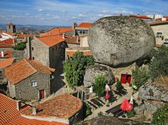 The Village of Monsanto is located on the side of a mountain in Portugal and is home to an incredible sight. With houses squeezed between gigantic boulders and tiny streets carved through the rocks, the village's appearance hasn't changed in centuries