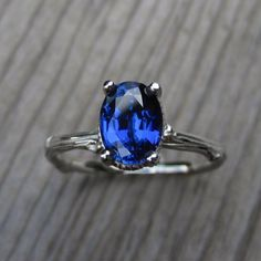 Sapphire engagement ring by Kristin Coffin | http://emmalinebride.com/engagement/blue-engagement-rings/