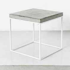 Concrete Topped White Cube - Side Table, End or Coffee Table, Stool. Clear-coated concrete. Silk-white steel. The perfect combination. 1.5-inch clear-coated concrete top on a square steel tubing frame. Perfect end table, stool table, side table, or anything you can think of. Combine to create something unique. Subtle, simple industrialism. Minimal, modular, and handmade. Right here in Los Angeles. 17 x 17 x 17 inches.