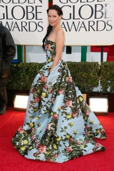 12 Winning Red Carpet Looks From Awards Season  We don't typically think of Lucy Liu as a red carpet daredevil, but this garden-print Carolina Herrera gown might change our minds. Her braid, her gown, her makeup...perfection!