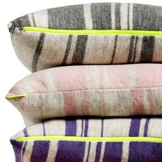 stripy pillows with neon yellow  zippers